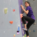 two members climbing rock wall