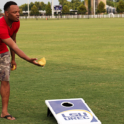 Photo of student playing corn hole