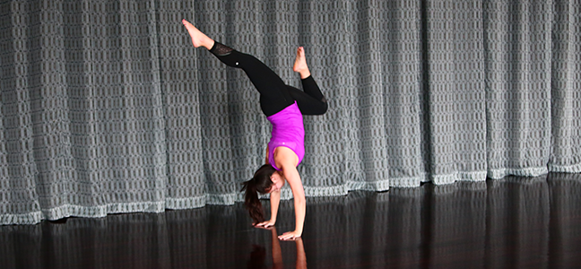 yoga instructor doing handstand