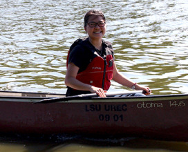person in canoe