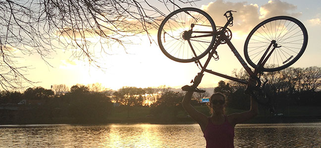 bike with lake and sunset background
