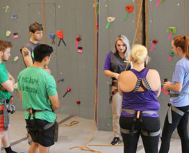 adventure supervisor teaching climbing class