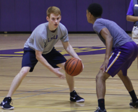 Photo of two students playing intramural basketball