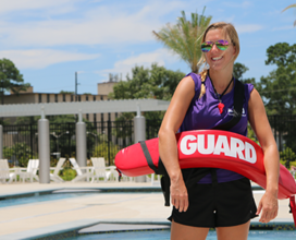 lifeguard standing by pool